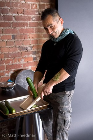 Tiberio slicing the cucumbers
